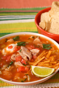 Chicken and tortilla soup with lime and chips